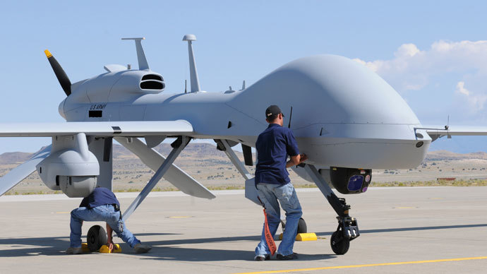 Workers prepare an MQ-1C Gray Eagle unmanned aerial vehicle for static display at Michael Army Airfield, Dugway Proving Ground in Utah in this September 15, 2011 US Army handout photo obtained by Reuters February 6, 2013.(Reuters / Spc. Latoya Wiggin)