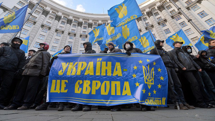 "Protesters hold a placards reading ""Ukraine is Europe"" as they block the Ukrainian Cabinet of the Ministers building in Kiev on December 2, 2013. (AFP Photo / Sergei Supinsky)"