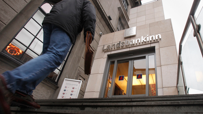 A customer walks into the main branch of Landsbankinn Bank in downtown Reykjavik (Reuters / Bob Strong)