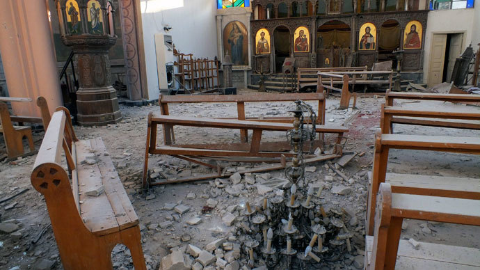 A fallen chandelier lies on debris in Im Al-Zinar church that was damaged during clashes between Syrian Rebels and the Syrian Regime in Bustan al Diwan, Homs July 23, 2012.(Reuters / Yazen Homsy)