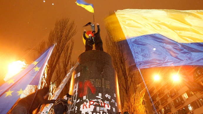 People climb up to the top of a pedestal after a statue of Soviet state founder Vladimir Lenin was toppled by protesters during a rally organized by supporters of EU integration in Kiev, December 8, 2013. (Reuters / Vasily Fedosenko)