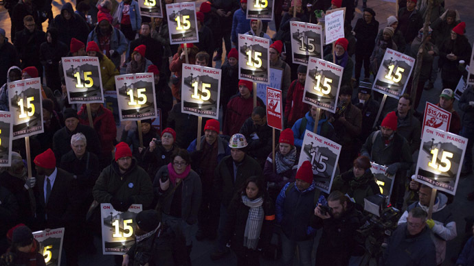 Demonstrators stage a rally after a long march from Sea-Tac to raise the hourly minimum wage to $15 for fast-food workers at City Hall in Seattle, Washington December 5, 2013. (Reuters/David Ryder)