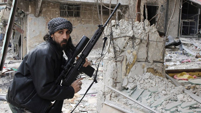A rebel fighter from the Free Syrian Army holds a position with a Belgium made FAL rifle at a front line in the Salah al-Din neighbourhood of the northern Syrian city of Aleppo, on December 1, 2013. (AFP Photo / Mohammed Al-Khatieb)