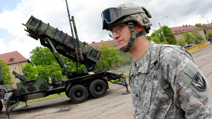 A U.S. soldier stands next to a Patriot surface-to-air missile battery at an army base in Morag, Poland (Reuters / Peter Andrews)