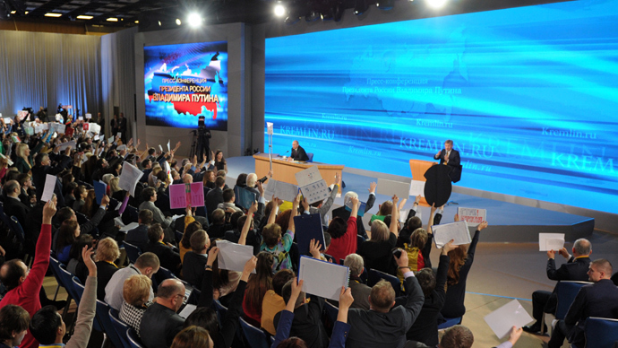 Russian President Vladimir Putin, far center, answers journalists' questions at the annual big news conference in the World Trade Center, Krasnaya Presnya, Moscow, December 19, 2013. (RIA Novosti / Aleksey Nikolskyi)
