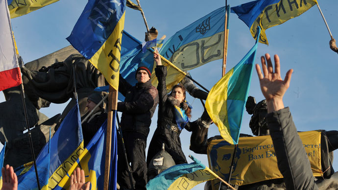 Ukrainian opposition supporters raise their hands as they take part in a mass rally on Independence Square in Kiev, on December 22, 2013.(AFP Photo / Genya Savilov)