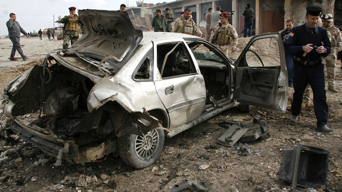Iraqi security forces inspect the site of a blast in Bartala in the Nineveh province, north of Baghdad, on January 16, 2012. (AFP photo)