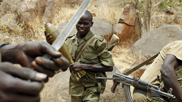 SPLA-N fighter stands with a mortar shell near Jebel Kwo village in the rebel-held territory of the Nuba Mountains in South Kordofan (Reuters/Goran Tomasevic)