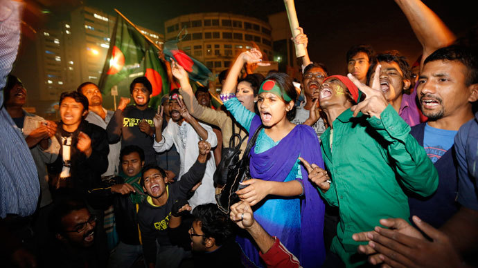 People celebrate after hearing the news of Bangladesh Jamaat-E-Islami leader Abdul Quader Mollah's execution in Dhaka .(Reuters / Andrew Biraj)