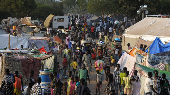 People gather at a makeshift IDP camp at the United Nations Mission in South Sudan (UNMISS) compound in Juba on December 22, 2013 where South Sudanese continue to flock as fears of a resumption of fighting in the capital fester.(AFP Photo / Tony Karumba)