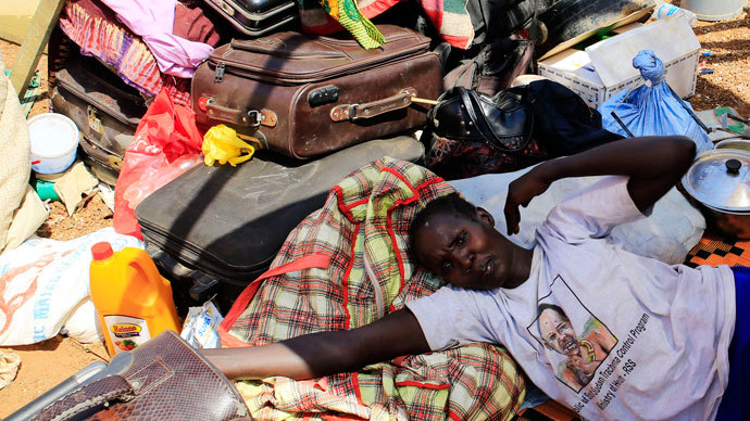 A mother displaced by recent fighting in South Sudan rests on top of her belongings inside a makeshift shelter at the United Nations Mission in Sudan (UNAMIS) facility in Jabel, on the outskirts of capital Juba December 23, 2013.(Reuters / James Akena)