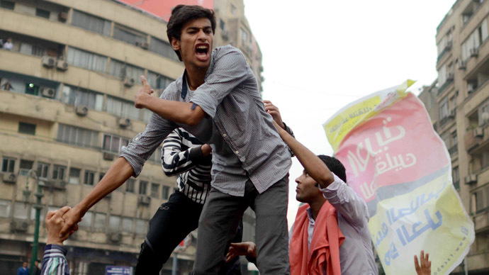 "Cairo University's students backing ousted Islamist president Mohamed Morsi shout slogans during a demonstration against July's military ""coup,"" in Tahrir square on December 1, 2013 in Cairo, Egypt.  (AFP Photo)"