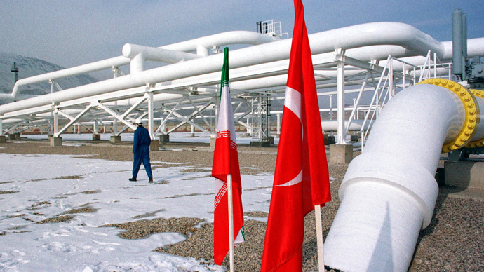 A worker walks past the pumping station on the border between Iran and Turkey (Reuters)