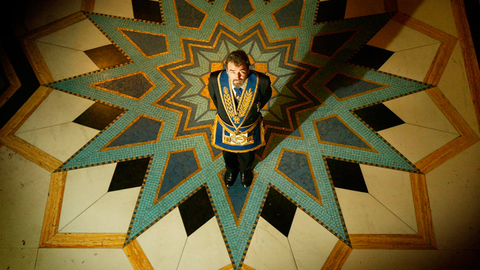 Former Freemason Senior Grand Deacon John Hamill poses for photographs<br /><br /><br />inside the Grand Temple in London June 26, 2002.<br /><br /><br />(Reuters / Peter Macdiarmid)