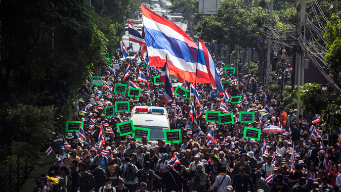 Anti-government protesters take part in a rally in Bangkok's financial district January 23, 2014. (Reuters / Nir Elias)