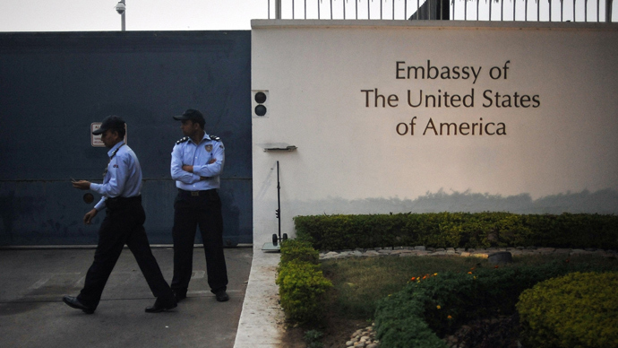 US embassy security personnel watch after barricades were removed in front of the US Embassy in New Delhi on December 17, 2013. (AFP Photo / Findlay Kember)