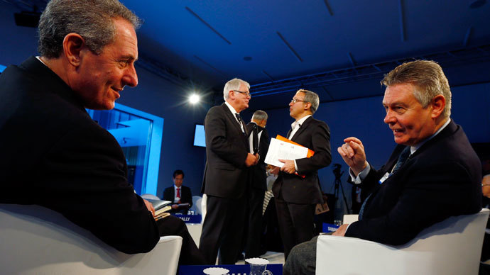 Michael Froman, U.S. Trade Representative (L) and European Union Trade Commissioner Karel De Gucht attend a session at the World Economic Forum (WEF) in Davos January 25, 2014.(Reuters / Denis Balibouse)
