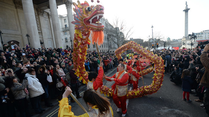 A dragon is carried during a parade celebrating Chinese New Year, the Year of the Horse, in central London February 2, 2014. (Reuters/Neil Hall)