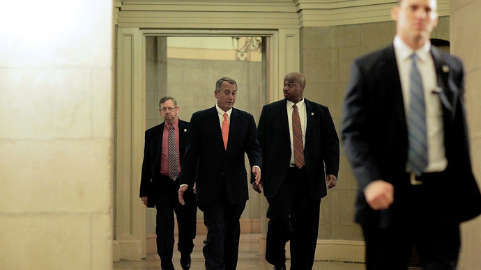 Speaker of the House U.S. Rep. John Boehner (2ndL) leaves from the Capitol building with his security detail on February 11, 2014 in Washington, DC.(AFP Photo / T.J. Kirkpatrick)
