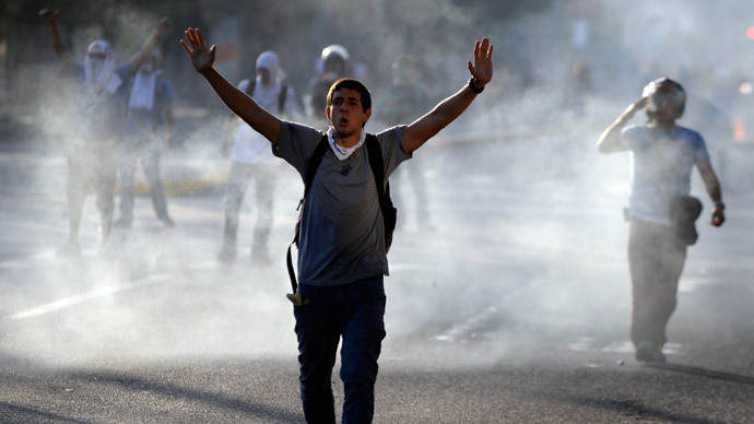 An anti-government student gestures during a protest in Caracas on February 16, 2014.(AFP Photo / Juan Barreto)