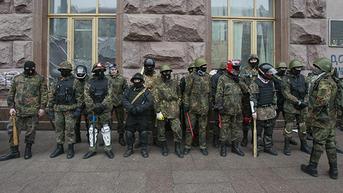 Anti-government rioters are seen as they leave city hall in Kiev February 16, 2014. (Reuters / Gleb Garanich)