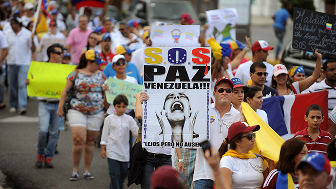 Venezuelans living in Dominican Republic take part in a rally against Venezuela's President Nicolas Maduro, on Lincoln Street of Santo Domingo February 23, 2014 (Reuters / Ricardo Rojas)