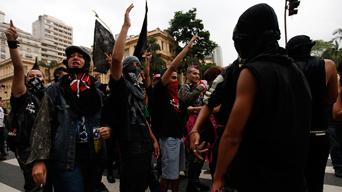 Members of the group called Black Bloc shout slogans during a protest against the 2014 World Cup in Sao Paulo in this February 22, 2014 file photo (Reuters / Paulo Whitaker)