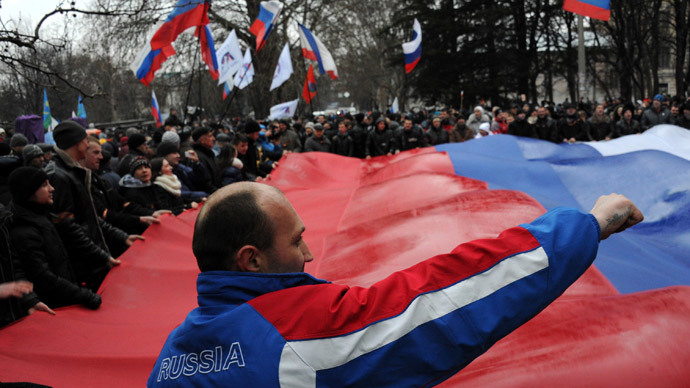 Pro-Russian demonstrators carry a giant Russian flag as they rally in central Simferopol on February 27, 2014. (AFP Photo / Viktor Drachev)
