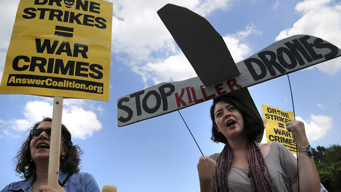 Protesters against drone strikes gather in an attempt to deliver a letter to U.S. Central Intelligence Agency (CIA) Director John Brennan as they gather outside CIA headquarters in Langley, Virginia, June 29, 2013. (Reuters/Jonathan Ernst)