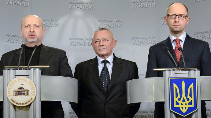 Ukraine's self-proclaimed President Aleksander Turchinov (L), Prime Minister Arseny Yatseniuk (R) and Defense Minister Igor Tenyukh (Reuters/Andrew Kravchenko)