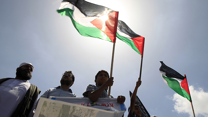 FILE PHOTO. Palestinians take part in a demonstration in Gaza city. (AFP Photo / Said Khatib)