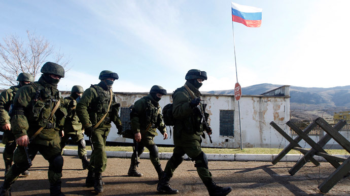 Armed men believed to be Russian servicemen march outside a Ukrainian military unit in the village of Perevalnoye outside Simferopol, March 5, 2014. (Reuters / Vasily Fedosenko)