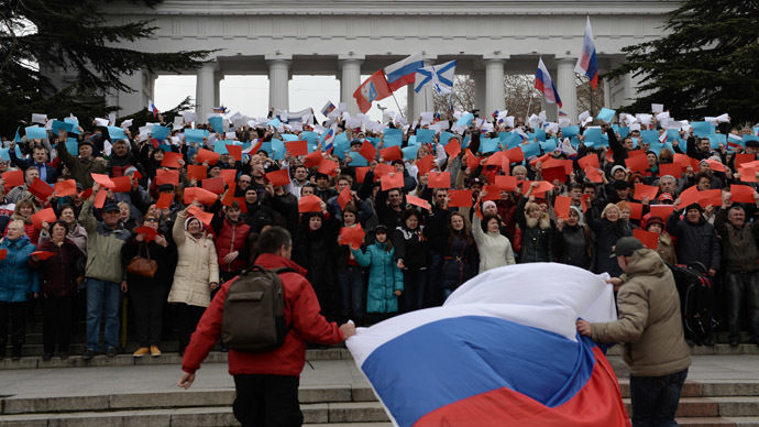 Participants hold different-colored pieces of paper to display the Russian flag at the rally in support of the Crimean Parliament and Sevastopol City Council's decision to reunite with Russia, staged on Nakhimov Square in Sevastopol. (RIA Novosti/Valeriy Melnikov)
