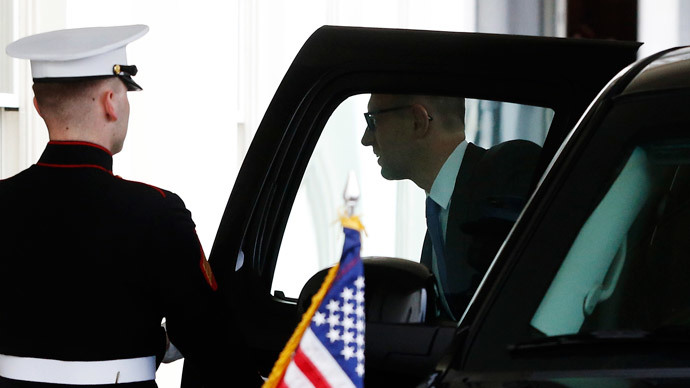 A U.S. Marine holds the door as Ukraine's Prime Minister Arseniy Yatseniuk arrives to meet with U.S. President Barack Obama at the White House in Washington March 12, 2014.(Reuters / Jonathan Ernst)
