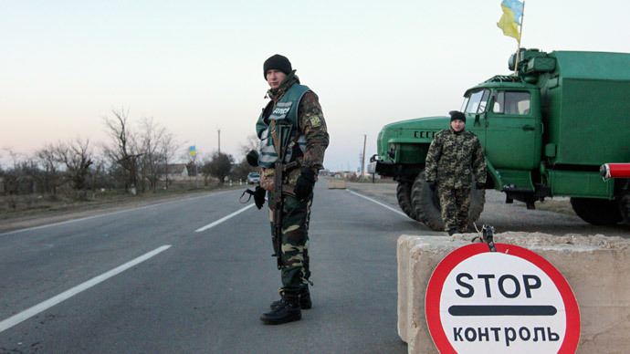 Ukrainian soldiers man a checkpoint near the village of Chongar, near a Crimea region border March 10, 2014.(Reuters / Valentyn Ogirenko)