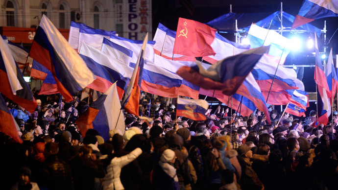 Pro-Russian Crimeans wave Russian flags as they gather to celebrate in Simferopol's Lenin Square on March 16, 2014 after exit polls showed that about 93 percent of voters in Ukraine's Crimea region supported union with Russia.(AFP Photo / Dimitar Dilkoff)