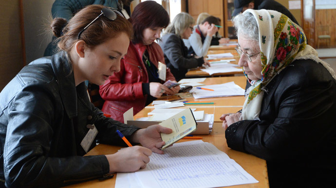 Residents prepare to cast their votes at a polling station in Simferopol during the referendum on Crimea's secession. (RIA Novosti / Mikhail Voskresenskiy)