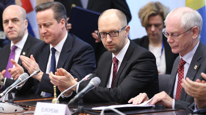 Ukrainian Prime Minister Arseniy Yatsenyuk (2nd-R) meets with EU leaders during the signing of the political provisions of the Association Agreement with Ukraine at the EU headquarters in Brussels on March 21, 2014 on the second day of a two-day European Council summit.(AFP Photo / Olivier Hoslet)