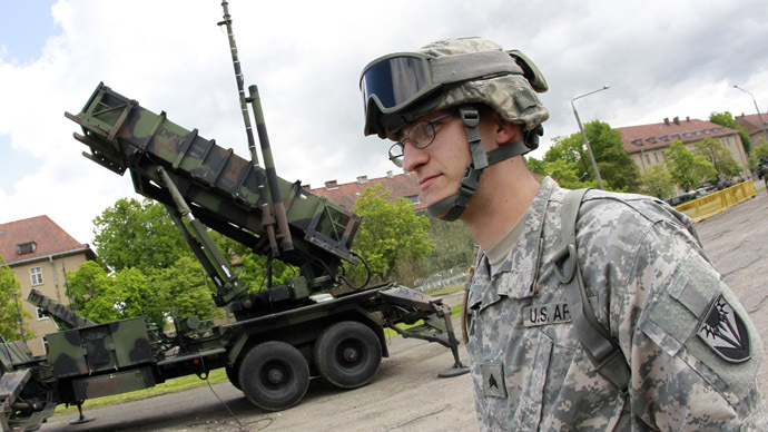 A U.S. soldier stands next to a Patriot surface-to-air missile battery at an army base in Morag, Poland May 26, 2010. (Reuters/Peter Andrews)