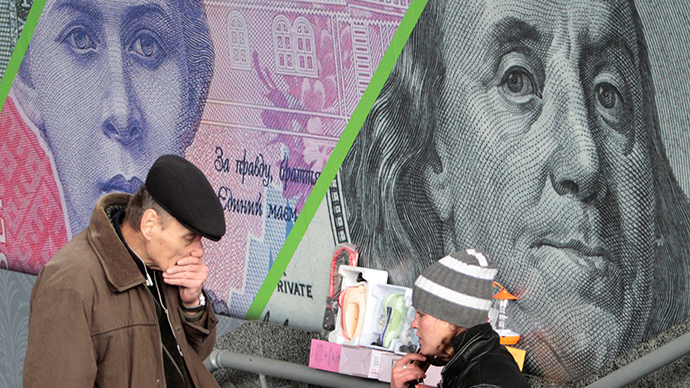 A customer and street vendor are seen before the background of an outdoor ad with an image of the Ukrainian hryvnia and U.S. dollar bank notes in central Kiev (Reuters / Anatolii Stepanov)