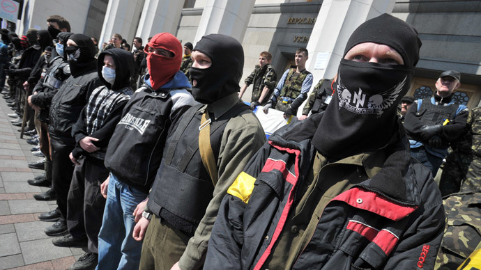 Supporters of the right wing party Pravyi Sector (Right Sector) protest in front of the Ukrainian Parliament in Kiev on March 28, 2014.(AFP Photo / Genya Savilov)