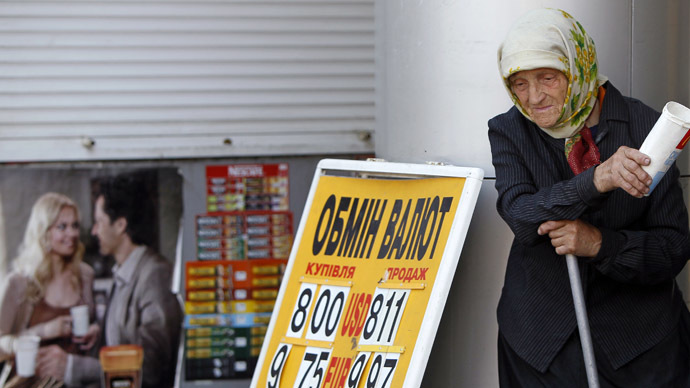 An elderly woman begs for money near a currency exchange office in Kiev (Reuters/Gleb Garanich)