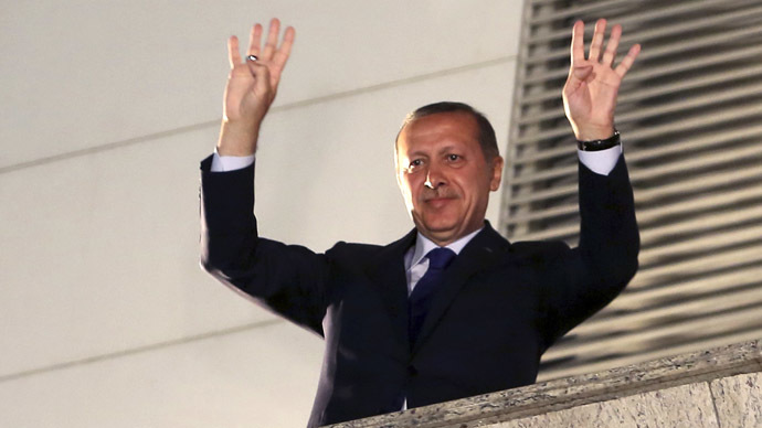 Turkey's Prime Minister Tayyip Erdogan greets his supporters in Ankara March 31, 2014. (Reuters)