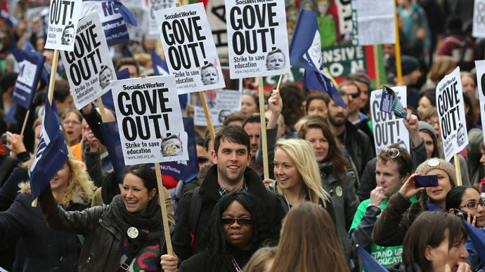 Teachers hold placards and banners during a march in central London March 26, 2014. (Reuters / Paul Hackett)