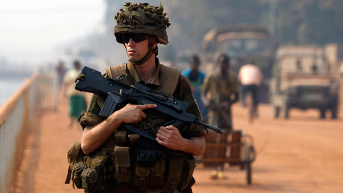 A French peacekeeping soldier patrols a street of the capital Bangui (Reuters / Siegfried Modola)