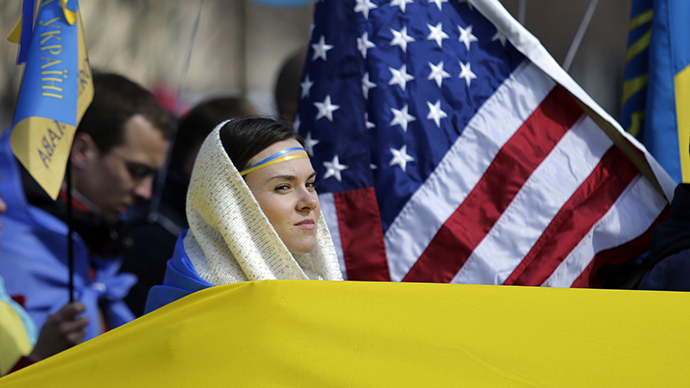 Woman is surrounded by Ukraine and US flags during protest in Lafayette Square in Washington (Reuters / Gary Cameron)