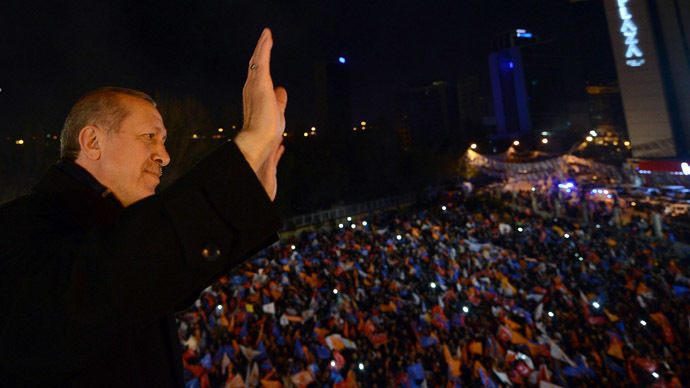 A March 30, 2014 handout picture released by the Prime Minister Press Office shows Turkey's Prime Minister Tayyip Erdogan greets his supporters in Ankara on March 30, 2014.  (AFP Photo)