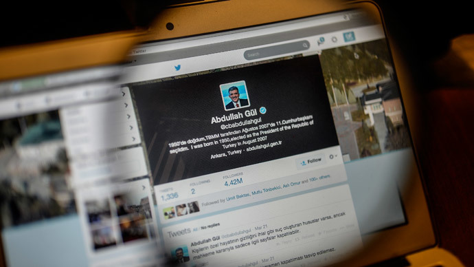 Turkish Prime Minister Recep Tayyip Erdogan's twitter account is seen on a computer screen through a magnifying glass on March 26, 2014 in Istanbul. (AFP Photo / Bulent  Kilic)