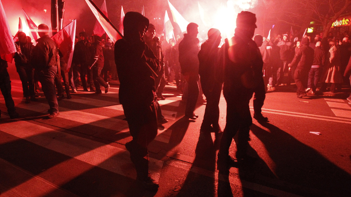 Far-right protesters walk during the annual far-right march, which coincides with Poland's National Independence Day in Warsaw (Reuters / Kacper Pempel)