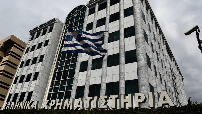 A Greek flag waves outside the Athens stock exchange on April 10, 2014. (AFP Photo / Aris Messinis)